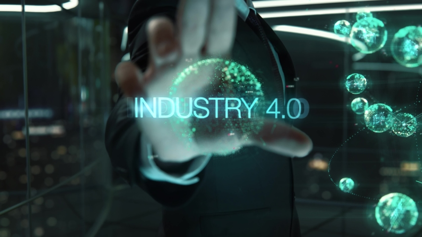 Businessman with Industry 4.0 hologram concept Royalty-Free Stock Footage #1040145269