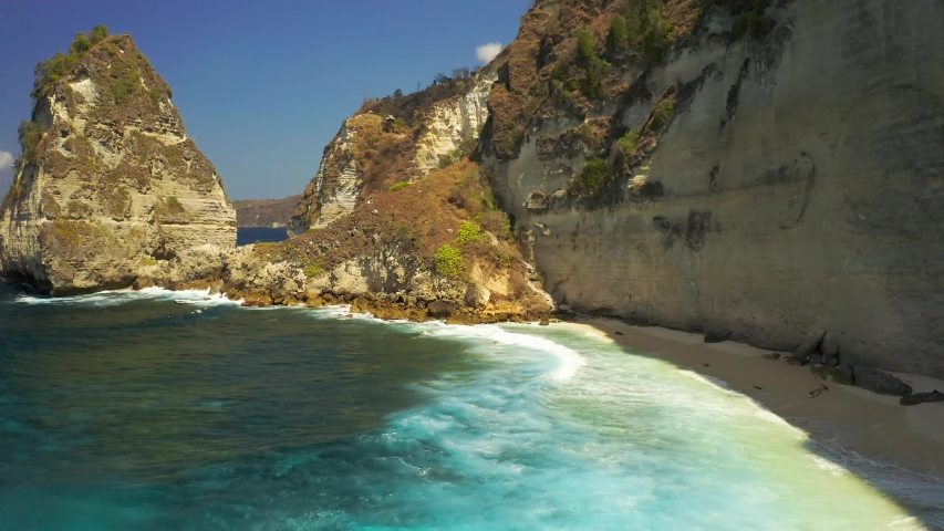 Aerial view Rocky shore and ocean with waves and rocky cliffon Nusa Penida island, Bali in Indonesia. Aerial view 4K | Shutterstock HD Video #1040149520