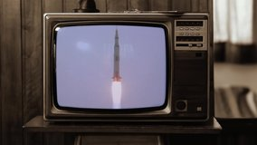 1969. Historical Footage of the NASA Apollo 11 Launch On an Old Retro TV. Sepia Tone. Elements of this video furnished by NASA.