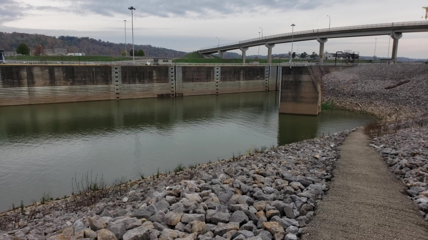 Dreary October morning on the Ohio river in Apple Grove, WV, USA Looking at south side of Robert C Byrd locks and dam public access area. | Shutterstock HD Video #1040152871