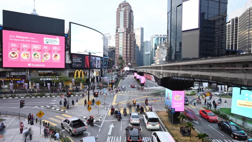 Kuala Lumpur, Malaysia, October 31, 2019. Time lapse video of traffic jam in a road intersection in Bukit Bintang. Bukit Bintang is the shopping and entertainment district of Kuala Lumpur, Malaysia.