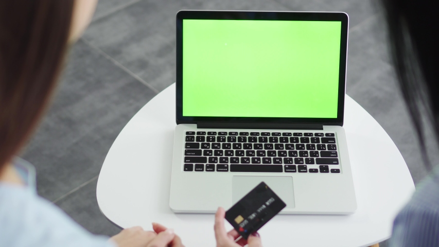 Close-up hands of two girlfriends enter credit card details to make an online purchase, black friday concept | Shutterstock HD Video #1040171369