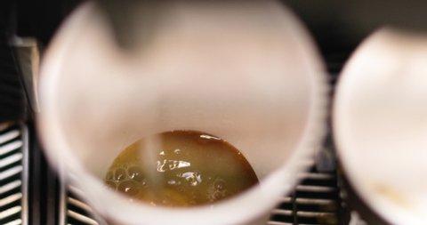 Preparing natural hot ginger tea using modern machine, closeup