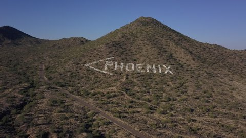 A 4k aerial video of a directional sign depicting to way to Phoenix.