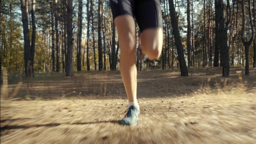 Running Man In Forest At Sunset.Runner Man Fit Athlete Legs Jogging On Trail Ready To Triathlon.Triathlete Running,Sprinting And Endurance Workout Training.Marathon Runner Jog On Trail.Sport Concept. | Shutterstock HD Video #1040190707