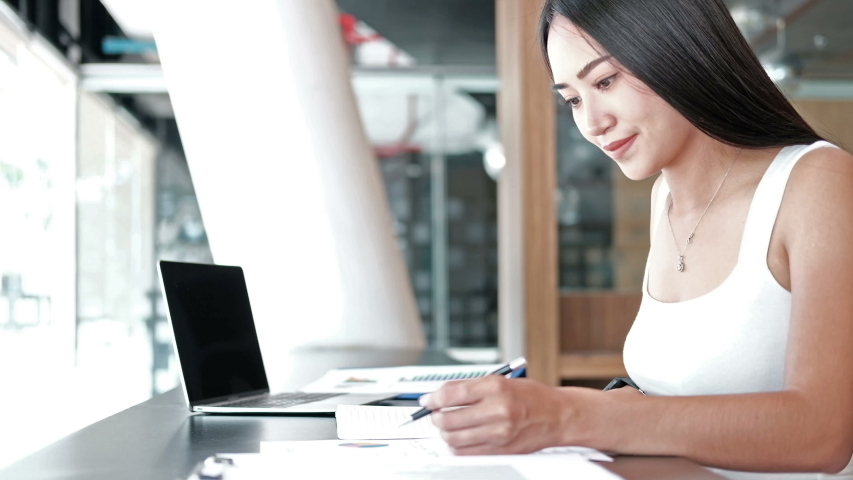 businesswoman working with business document at office. Startup woman entrepreneur student studying writing note at workplace. #1040190713