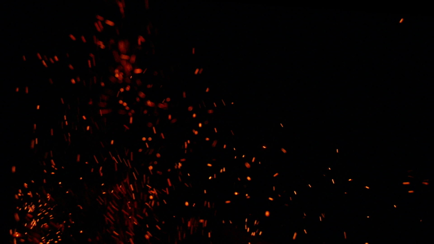 Slow motion flame with amazing flying embers. Real footage with beautiful flame detail, filmed in slow motion Royalty-Free Stock Footage #1040203040