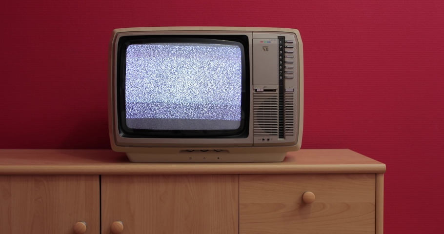 No signal noise on an old tube TV set in room with red wall, loopable | Shutterstock HD Video #1040208428