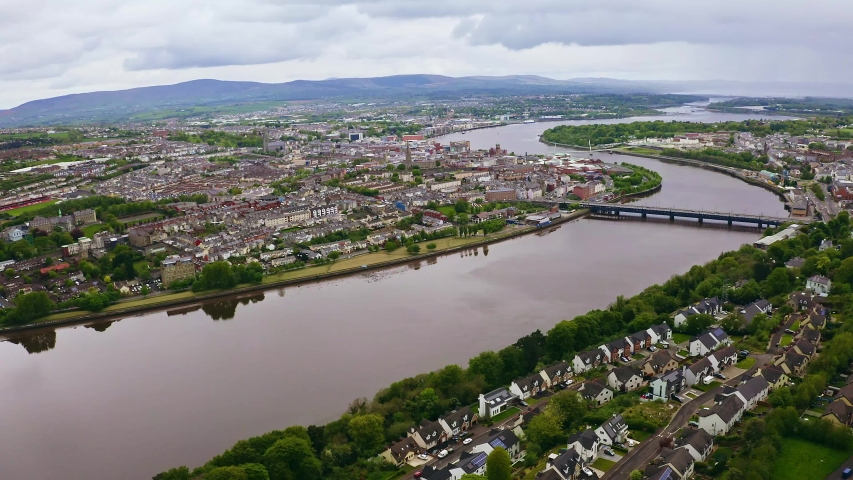 Aerial of beautiful Derry city and river Foyle flowing through the city in Northern Ireland | Shutterstock HD Video #1040230724