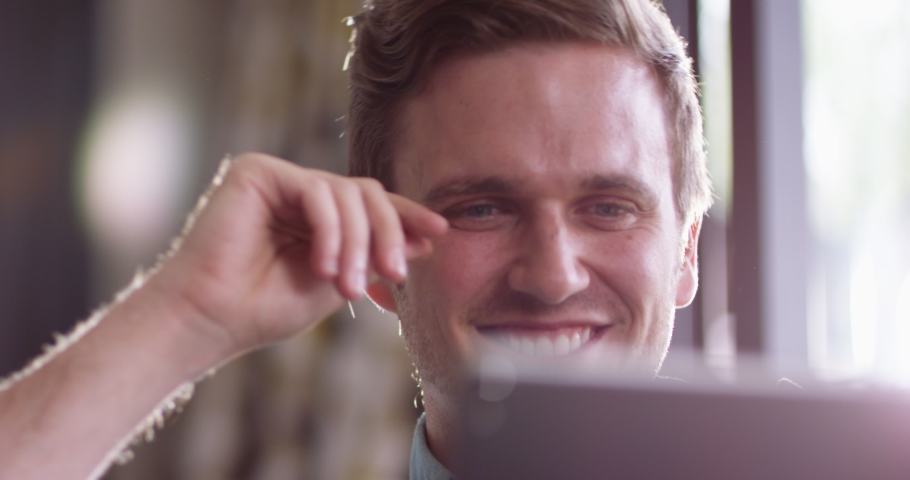 4K Close up on face of attractive man relaxing at home with computer tablet. Slow motion. Royalty-Free Stock Footage #1040251340