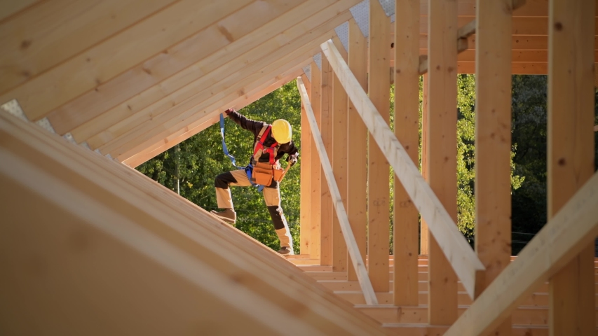 New Wooden Residential Building Developing. Caucasian Contractor Worker and the Wood Frame Installation. Construction Industry. | Shutterstock HD Video #1040289545
