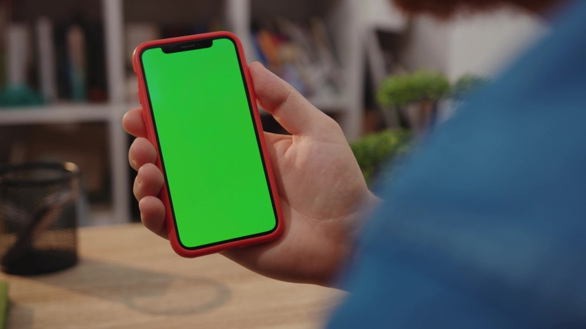 NEW YORK - April 5, 2019: Young man hands use his smartphone with green screen scrolling news checking business gadget communication display technology touch device holding internet mobile cellphone | Shutterstock HD Video #1040298167