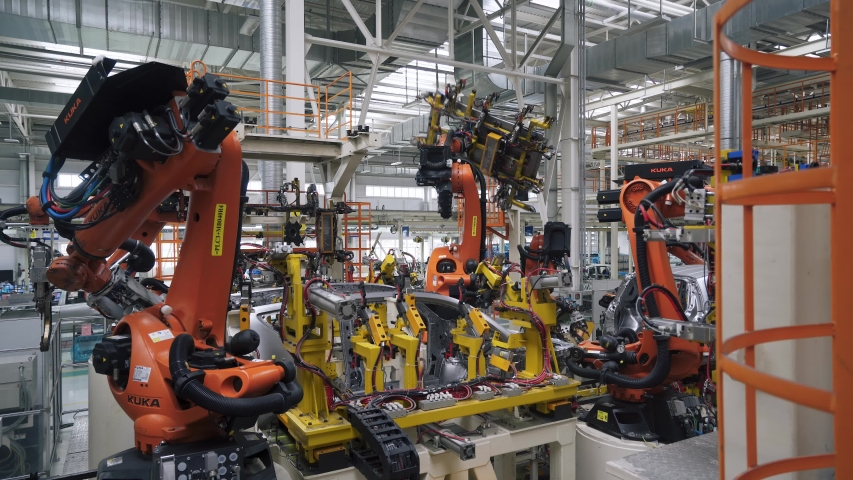BELARUS, BORISOV - AUGUST 7, 2019: Automobile plant, modern production of cars, car body assembly process, view of automated production line.   Shutterstock HD Video #1040321978