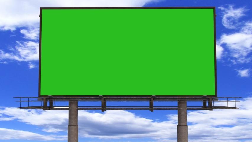 Billboard Green Screen Footage. Green Screen Video. Green Screen Billboard With Sky Animation. | Shutterstock HD Video #1040339039
