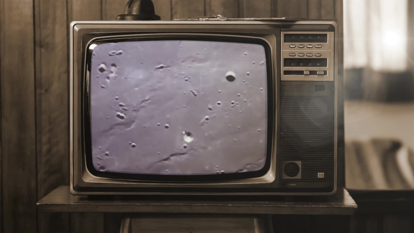 Historical Footage of the NASA Apollo 11 Moon Landing On an Old Retro TV. Sepia Tone. Elements of this video furnished by NASA.  | Shutterstock HD Video #1040340083