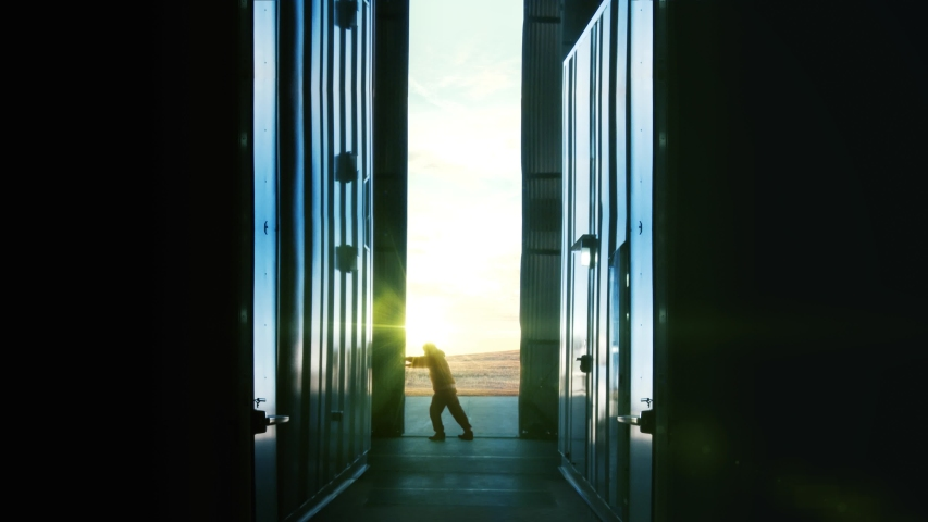 Man Opening Door of Container Warehouse at Sunset. Back to Work Concept.  | Shutterstock HD Video #1040351132