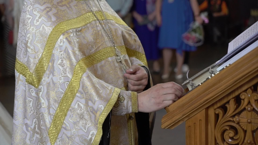 Priest praying in church. Christianity ceremony