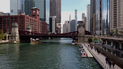 Chicago, Illinois - October 2019: Wide shot dolly on water taxi moving on Chicago river, view from wacker drive in 4k