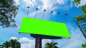 High-quality time-lapse day time video of a large green screen billboard on the street in Asia country for advertising video with chroma key.