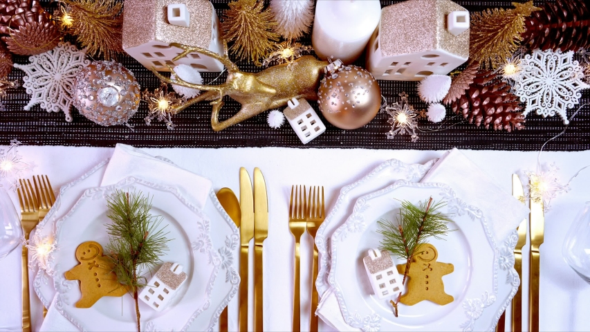 Festive Christmas Holiday Dinner Table Setting with rose gold, white and gold centerpiece decorations and elegant fine china tableware, flat lay overhead. Stop motion animation. | Shutterstock HD Video #1040368535