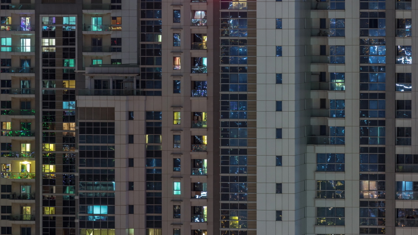 Lights from windows of offices and apartments aerial timelapse. Skyscrapers with working people in the evening in Business Bay, Dubai, United Arab Emirates. Complex of towers at night | Shutterstock HD Video #1040416883