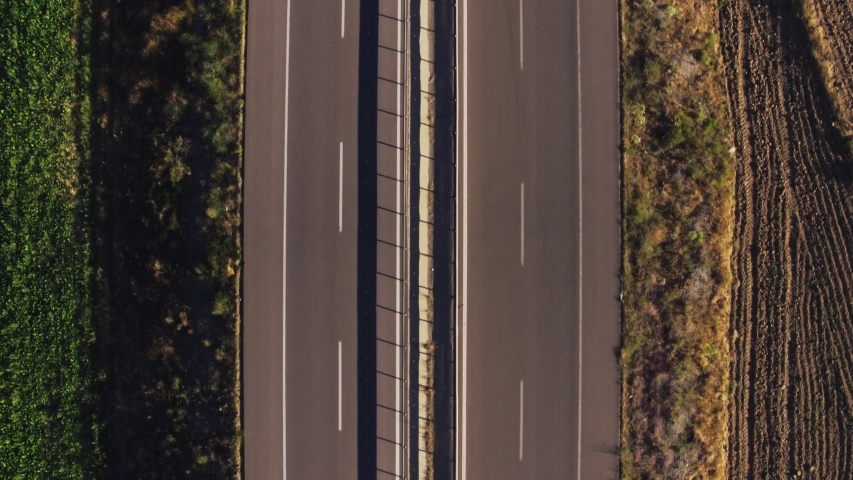 Empty endless road / two sided double way asphalt highway in dry rural landscape at summer sunny day / Aerial drone top view | Shutterstock HD Video #1040419208