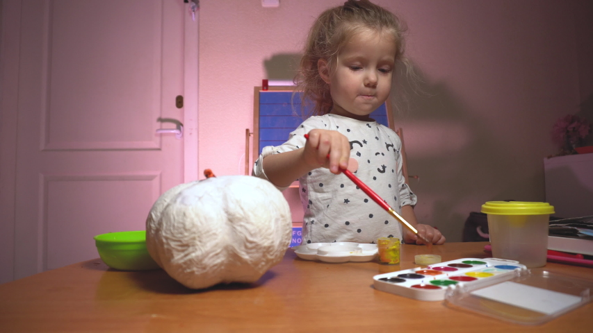 Little child girl crafting something for fun   Shutterstock HD Video #1040427608