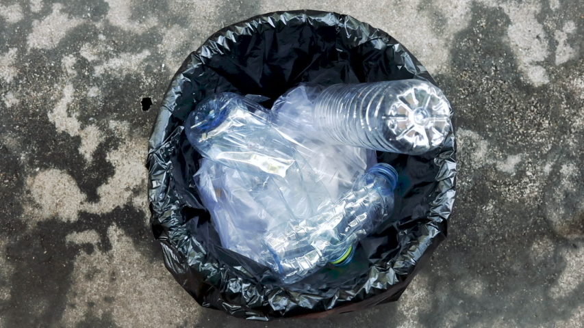 Top view Throw the plastic bottles into the trash. | Shutterstock HD Video #1040469143