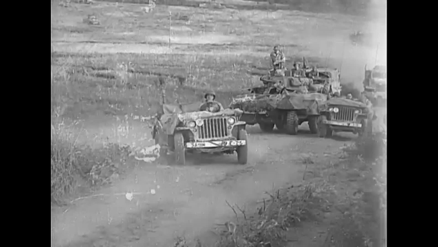CIRCA 1944 - US Army tanks, cars, and jeeps drive up a road towards Rome in World War Two..