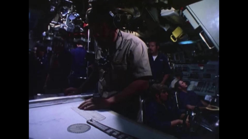 CIRCA 1970s - Officers refer to a chart and crewmen are shown aboard a United States Navy submarine. #1040474855
