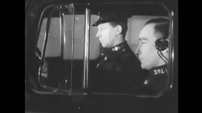 CIRCA 1940s - Police ride through London, spreading word of an air raid.