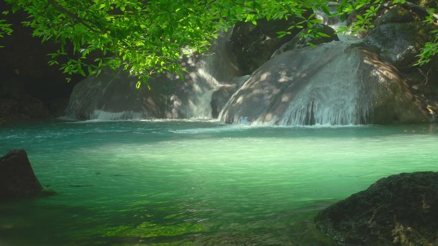 Beautiful Erawan waterfall in the tropical rain forest Erawan National Park, Kanchanaburi, Thailand             | Shutterstock HD Video #1040486798