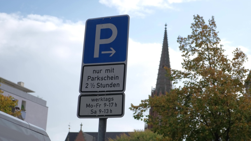 Hamburg / Germany-10.02.2019: blue road sign on the background of the Catholic Cathedral. | Shutterstock HD Video #1040494190