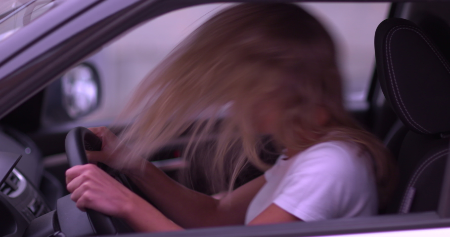 Young blond woman angry and screaming while waiting in traffic in slow motion 60 fps 4K