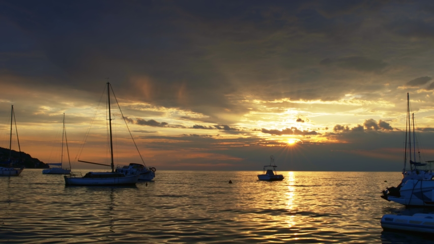 Beautiful sunset over small bay with ships | Shutterstock HD Video #1040498216