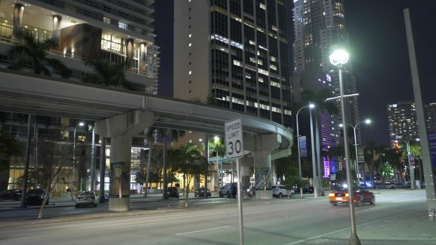 MIAMI, FL, USA - NOVEMBER 6, 2019: Tram rail tracks Downtown Miami Metromover 4k