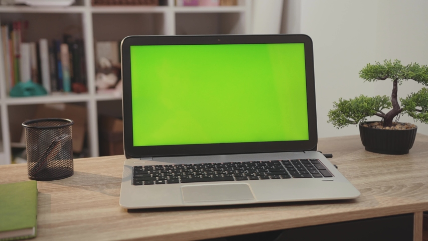 NEW YORK - April 5, 2019: Close up laptop computer with green screen chroma key display internet business office technology work desk connection keyboard pc device using slow motion   Shutterstock HD Video #1040531603