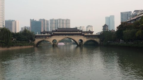 Aerial view of the Anshun Lang Bridge with the Jinjiang river surrounded by lot of buildings in the downtown of Chengdu, China
