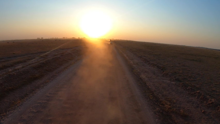 Hyperlapse of Off Road Vehicle Driving Through Dirt Road During Safari - timelapse on board - sunset from behind car | Shutterstock HD Video #1040559572