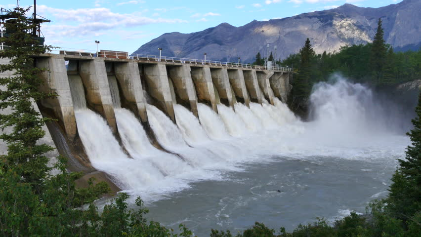 Wide shot of a hydroelectric dam and spillway in the mountains, Kananaskis Dam, Bow River, Alberta, Canada.
