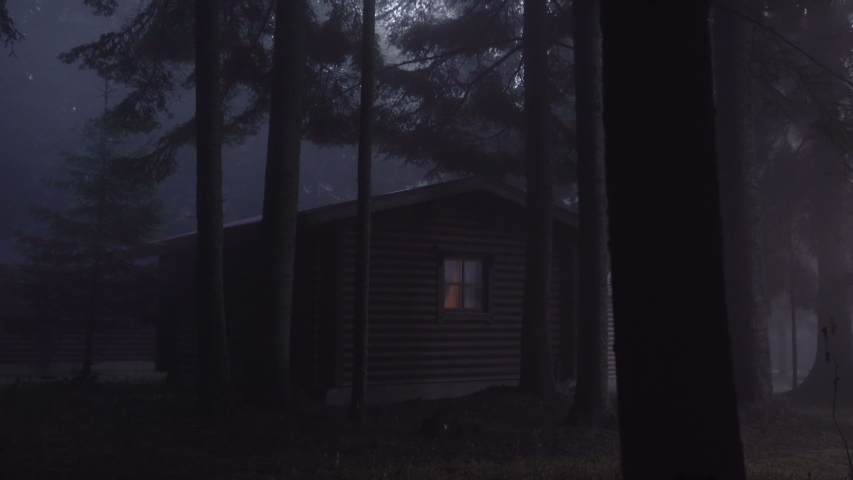 Spooky Cabin in the misty woods. Evergreen forest with fog Royalty-Free Stock Footage #1040578379