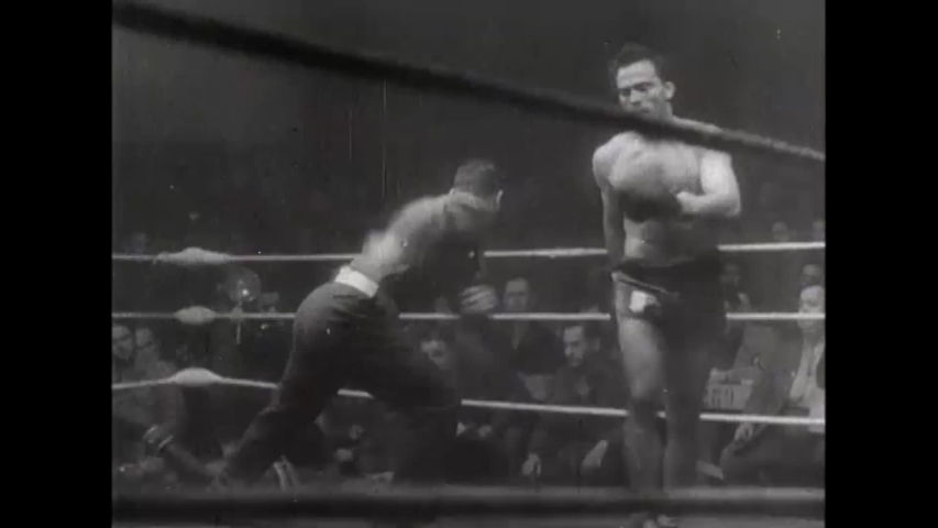 CIRCA 1940s - Newsreel footage of boxing matches by and for members of the American military during World War II