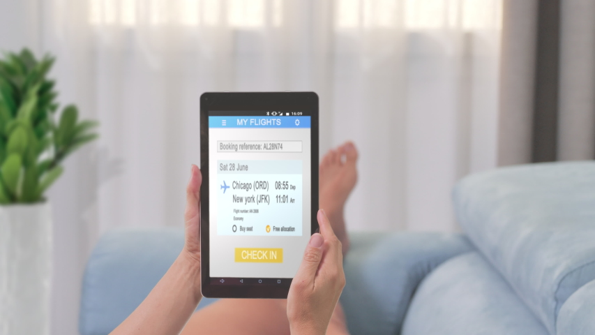Woman lying on couch check in online on tablet app | Shutterstock HD Video #1040589869