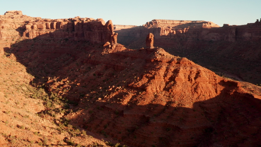 Aerial shot of the amazing rock formations on southern Utah.   Shutterstock HD Video #1040596022