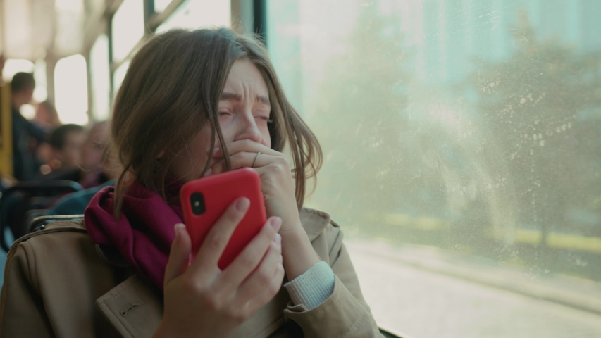 Young woman use phone sneezes coughs on the tram cold autumn day flu season disease fever grippe health illness infection influenza migraine sickness close up slow motion Royalty-Free Stock Footage #1040600966