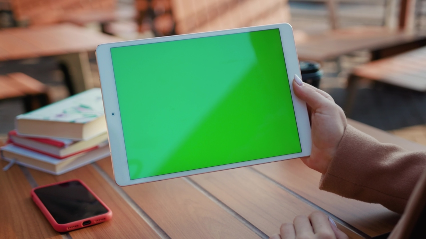 In cafe hand woman sitting use tablet computer with horizontal green screen typing display internet touchpad connection touchscreen communication chroma finger message mobile slow motion | Shutterstock HD Video #1040602295