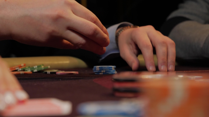 Dealer poker player with chips at casino table | Shutterstock HD Video #1040609378