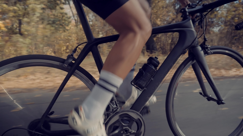 Gear System And Bike Wheel Rotation.Cyclist Twists Pedals And Riding On Bicycle.Cycling Athlete Cardio Endurance Workout.Cyclist Legs Triathlete Pedaling And Exercising Before Triathlon.Sport Concept   Shutterstock HD Video #1040632661