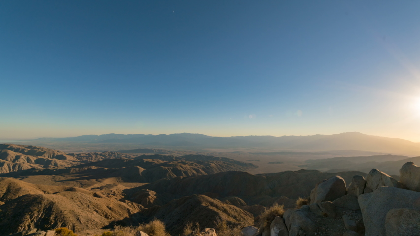 Timelapse day to night transition of Milky Way over badlands of Coachella Valley in California