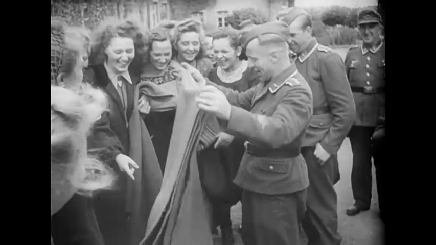 CIRCA 1940s - German women sign up for the war effort and work in factories producing clothing during World War 2